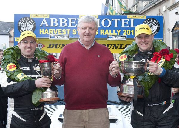 Brian O'Mahony (left) with his father Frank (centre) and co-driver John Higgins after he won the Dunlop National Rally Championship on the 2012 Donegal Harvest Rally. Picture: Martin Walsh.