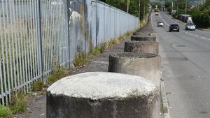 Threat to block the road to Apple over a delay in removing unsightly concrete bollards