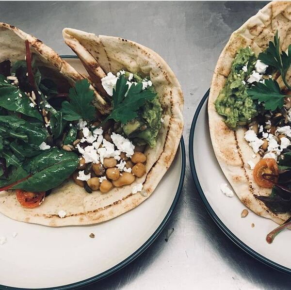 TASTY: Crushed avocado on Syrian flatbread with chipotle beans, Macroom Feta, toasted seeds & leaves