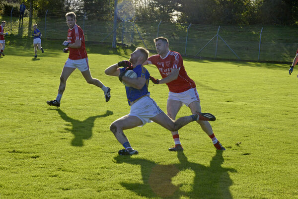 Kevin Manning (Iveleary) tries to halt Killian O'Hanlon, the captain of Kilshannig. Picture: Denis Boyle