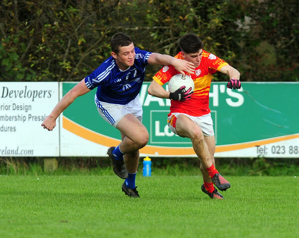 Éire Óg's Eoin Ó Sé  is tackled by Bantry Blues' Seanie O'Leary. Picture: Eddie O'Hare