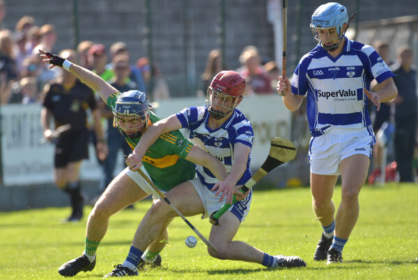David Morrison, Castlelyons, is held back by Jack O'Sullivan and watched by Ciaran Lombard, Inniscarra. Picture: Dan Linehan