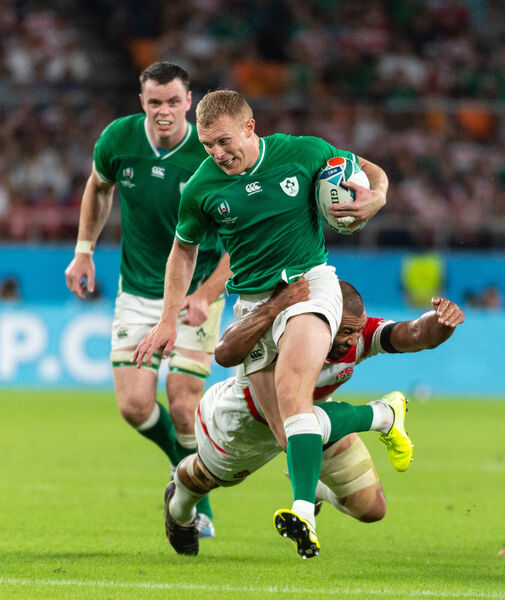Ireland's Keith Earls with Michael Leitch of Japan. Picture: INPHO/Jayne Russell