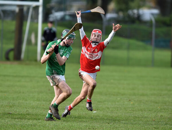 Colman's Michael O'Driscoll shoots from Midleton CBS' Tiernán Roche. Picture: Eddie O'Hare