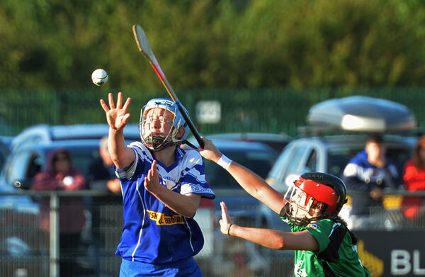 Inniscarra's Rena Buckley hand-passing the ball clear under pressure from Killeagh's Jessica O'Shea. Picture: Denis Minihane.