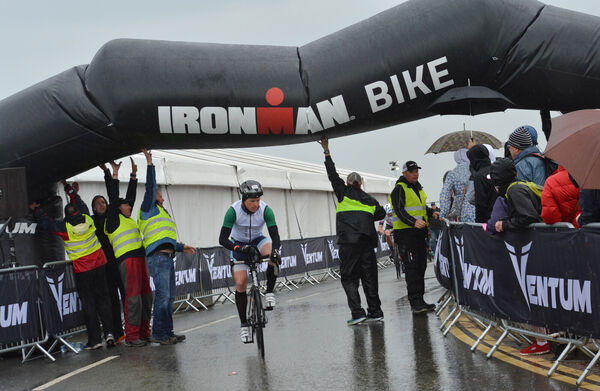 Stewards struggle to keep the inflatable race arch over the cyclists at the start of the Ironman in Youghal. Picture: Howard Crowdy