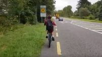 Father responds to Twitter criticism over video of child cycling to school