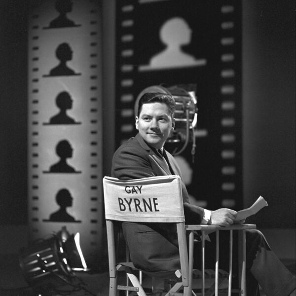 RTÉ broadcaster Gay Byrne in a 1964 publicity still for RTÉ Television's A World of Film, which Byrne presented throughout 1964 while commuting between Dublin and Granada TV in Manchester.