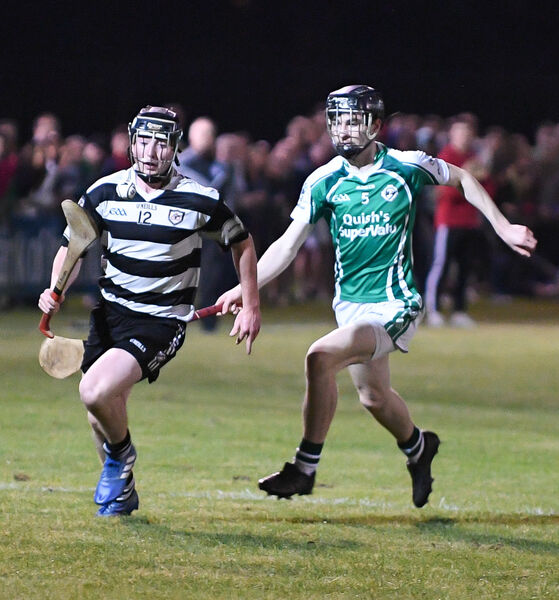 Midleton's Aaron Mulcahy gets away from Ballincollig's Sean O'Donoghue. Picture: David Keane.