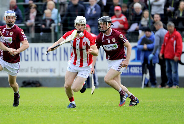 Imokilly's Brian Lawton gets past Bishopstown's Diarmuid Lester. Picture: Gavin Browne