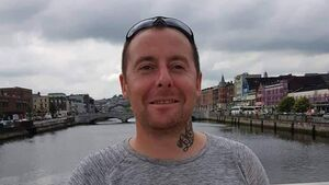 Gardaí investigating Cork murder have charged a man with trespassing to commit an assault