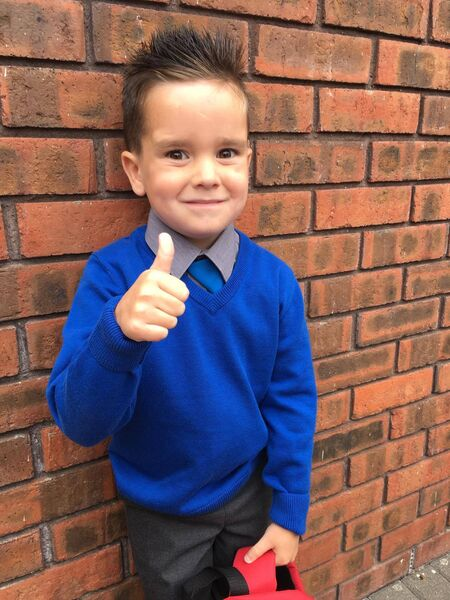 Cork boy Tom Tom Cahill celebrates beating cancer : Tom Tom Cahill gives thumbs up after his first full day at Saleen National School, Middleton, Co Cork.
