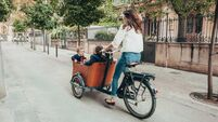 Mother riding bicycle