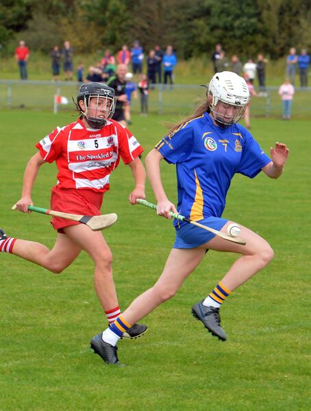 Nicole Olden of St Finbarr's soloing downfield chased by Courcey Rovers' Orla Twomey. Picture: Denis Minihane.