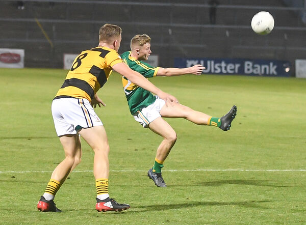 St Michael's Keith Hegarty shoots as Na Piarsaigh's Eoin Sheehan closes in. Picture: David Keane.