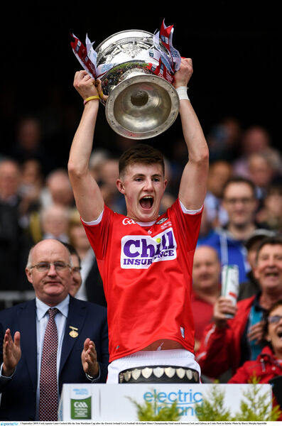 Cork captain Conor Corbett lifts the Tom Markham Cup. Picture: Harry Murphy/Sportsfile