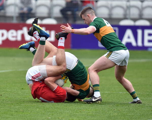 Mark Collins in a tangle with Kerry's Jason Foley watched by Tom O'Sullivan. Picture: Eddie O'Hare
