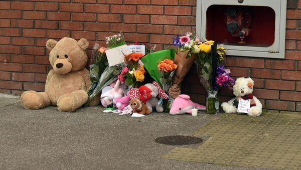 Teddy bears and flowers outside the Elderwood Apartments, Boreenmanna Road, following the death of toddler, Santina Cawley.Picture: Eddie O'Hare