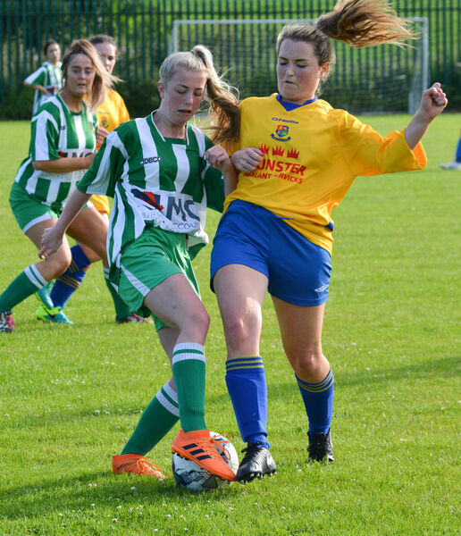 Laura Finlay of Passage clashes with Carrigaline's Orla Murphy. Picture: Howard Crowdy