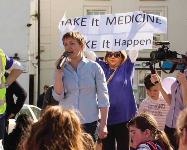 Vera Twomey addresses the crowds in Macroom's South Square, to continue protesting to Government to licence cannabis oil for Vera Twomey's daughter Ava Barry and other dependants of the oil. Picture: John Delea.