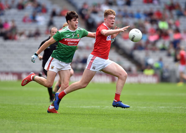 Hugh Murphy bursts past Mayo's Eoin Gilmore. Picture: Eddie O'Hare