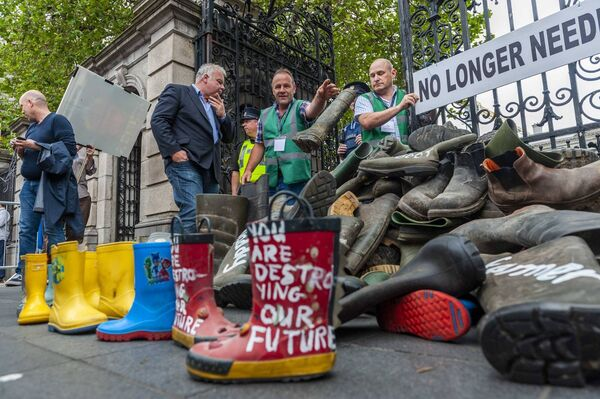 A West Cork beef farmer throws his wellington boots outside the Dáil to protest against the proposed Mercosur deal. Picture: Andy Gibson.