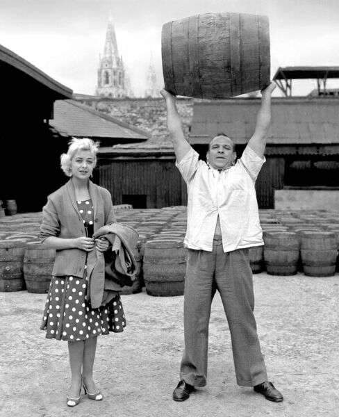 Kerry strongman Butty Sugrue lifts a full barrel of porter on a visit by Duffy's Circus to the Beamish and Crawford brewery in 1959.