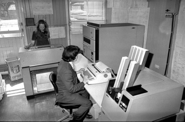 Workers operate Beamish and Crawford's recently-installed computer system in 1973.