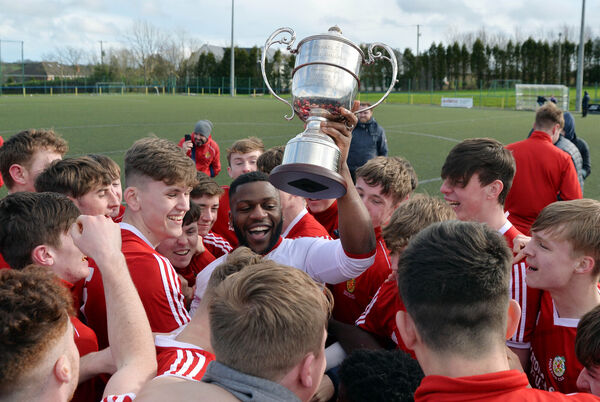 Midleton CBS celebrating their victory over Pres with their captain Arthur Nganou. Picture Denis Minihane.
