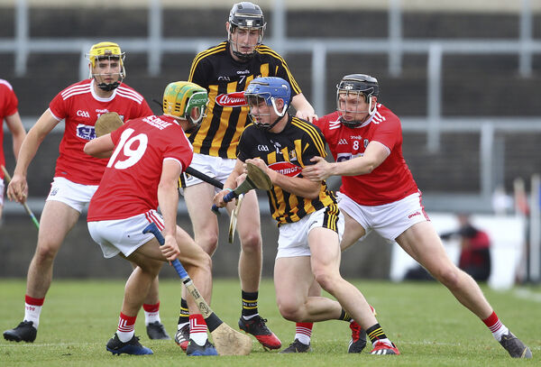 Kilkenny's Eoin O'Shea is tackled by Cork's Ryan Walsh and Brian Roche. Picture: INPHO/Ken Sutton