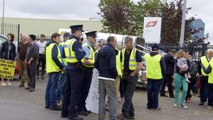 Traffic queues as farmers protest the price of beef at Cork factory