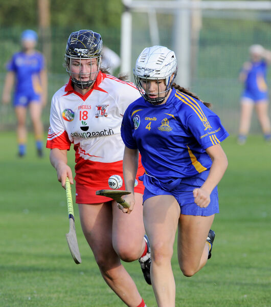 St Finbarr's Aoife O'Neill gets away from Ballygarvan's Molly Kelleher. Picture: Gavin Browne