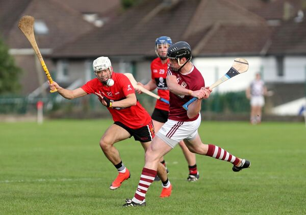 Shane O'Neill, Bishopstown, clears from Brian Verling, UCC. Picture: Jim Coughlan.