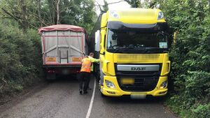 Epic Fail: Articulated trucks close road after getting stuck
