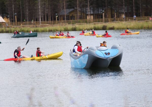 Families enjoy activities on the lake at Center Parcs. Picture: Leon Farrell/Photocall Ireland