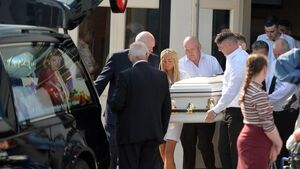 Devastated mourners pay their respects at removal of murdered toddler Santina Cawley