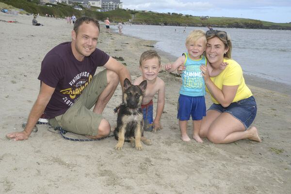 Pictured enjoying the fine weather at the beach at Inchydoney was Garry Waters and Tracey O'Keeffe with their children Keelen and Kallum and puppy Bonny. Picture Denis Boyle
