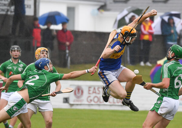 Carrigtwohill's Jamie McCarthy loses possession under pressure from Killeagh's Allen Keniry. Picture: David Keane.