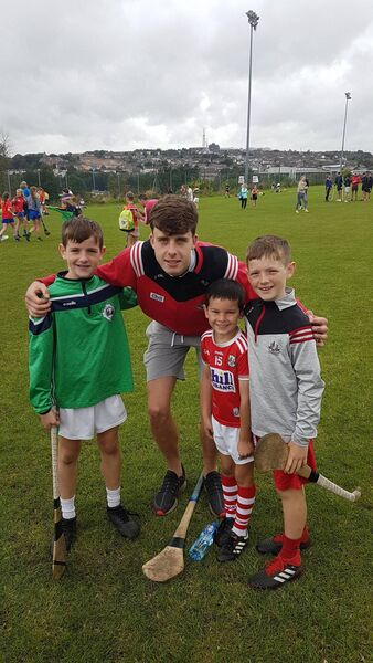 Cork hurler Robert Downey with Tadhg and Daithí Murphy and Cathal Downey, Ballincollig, at a camp in Glen Rovers.