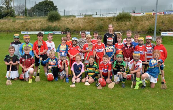 Cork camogie player Leanne O'Sullivan with the U8/9 group. Picture: Denis Minihane.