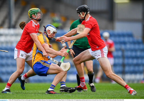 Diarmuid Ryan tackled by Brian Roche and Robert Downey. Picture: Brendan Moran/Sportsfile