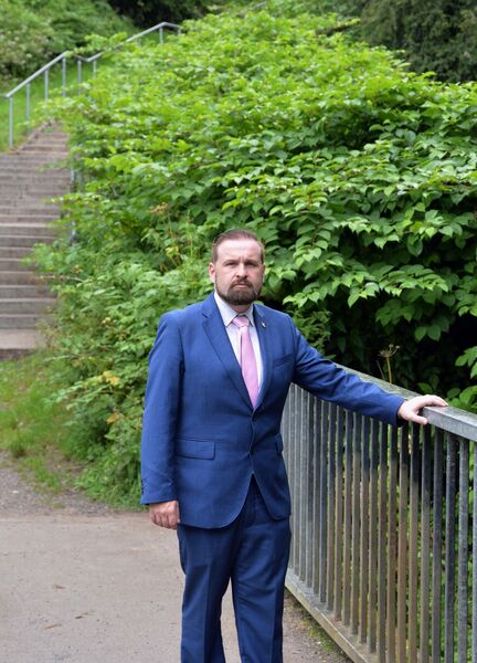 Cllr Ken O'Flynn in front of an area of knotweed at Glen River Park in Cork.Picture Denis Minihane.