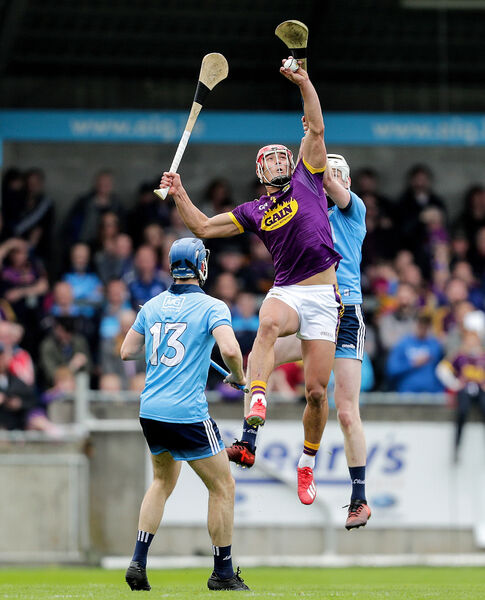 Wexford's Lee Chin and Shane Barrett of Dublin. Picture: INPHO/Laszlo Geczo