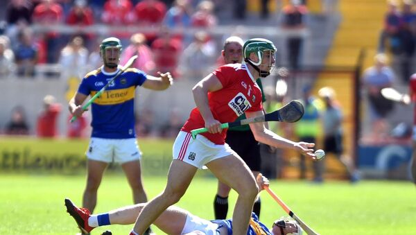 Robbie O'Flynn knocks over Tipperary's Michael Breen. Picture: Eddie O'Hare