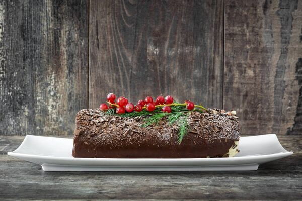 Chocolate yule log cake. Picture: Stock