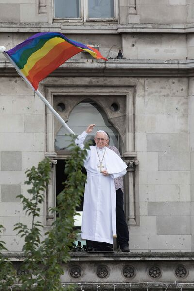 """LOVE IS NOT A SIN"": A life size figure of Pope Francis and a rainbow flag in a window overlooking O'Connell Bridge asthe Pope visited Dublin during hisvisit to Ireland last year."