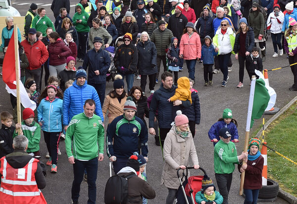 Kieran O'Connor, his wife Sinead and children leading the large crowd at the Friends of Kieran fundraising 5km walk. Picture: Eddie O'Hare
