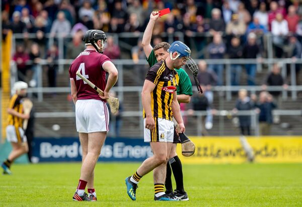 Ger Aylward is shown a red card by  Colm Lyons. Picture: INPHO/Morgan Treacy