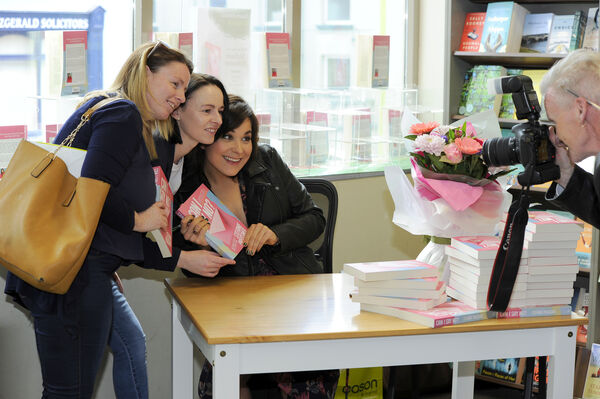 Irene Sheehan and Margaret Muphy from Mallow pose for a photo with author Stefanie Preissner at her book signing at Easons, Mallow, Co. Cork. Picture: Gavin Browne