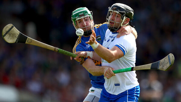 Tipeprary's Noel McGrath and Noel Connors of Waterford. Picture: INPHO/James Crombie
